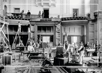 Plakat med gammelt billede af opbygningen af folketingssalen